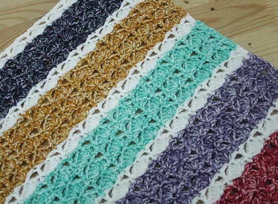 Crochet blanket Scheepjes Colour Crafter Velvet | Sea shell banket, crochet pattern by Happy in Red